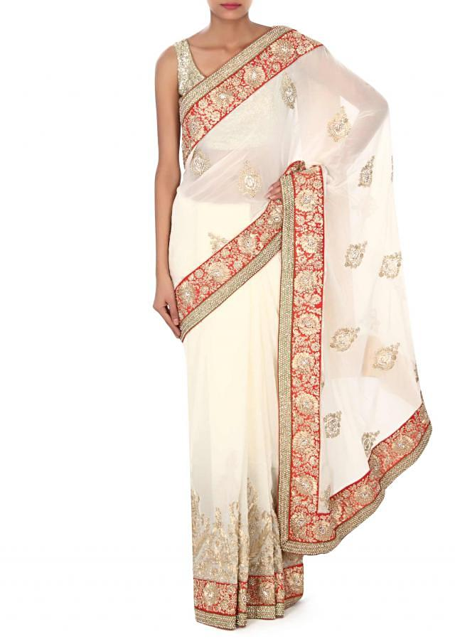 White saree adorn in zari and kundan embroidery only on Kalki