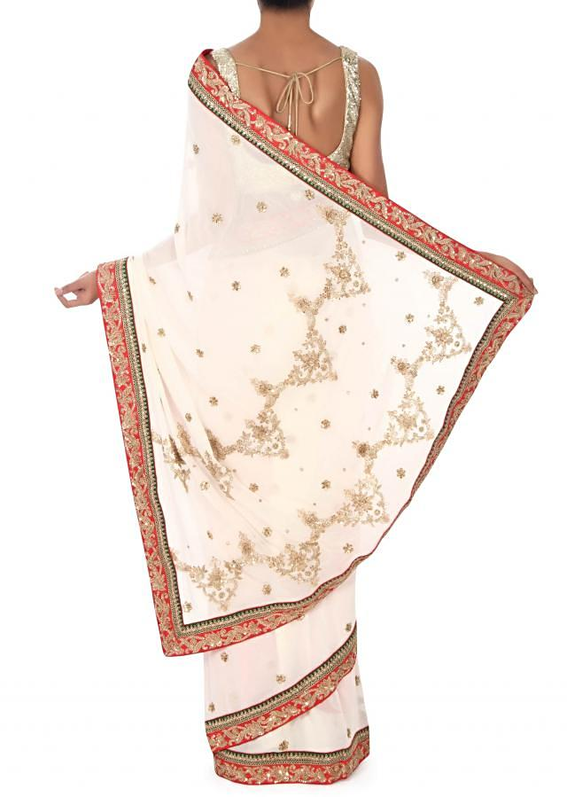 White Saree Embroidered In Zari And Kundan Embroidery Online - Kalki Fashion