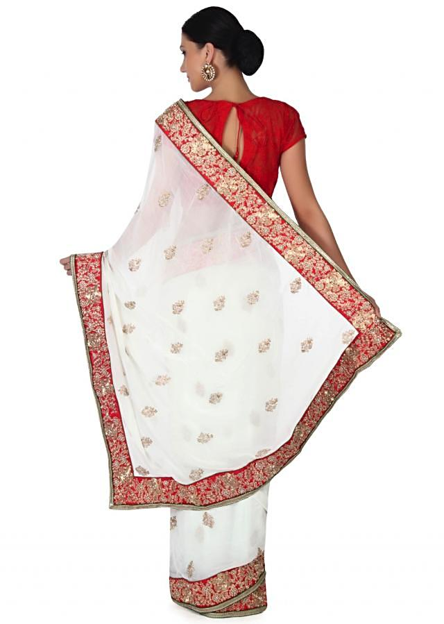 White saree adorn in zari and sequin embroidery only on Kalki