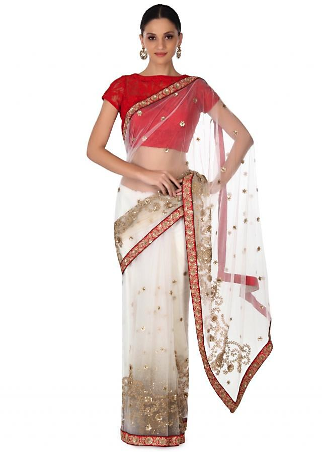 White saree in embroidered net only on Kalki