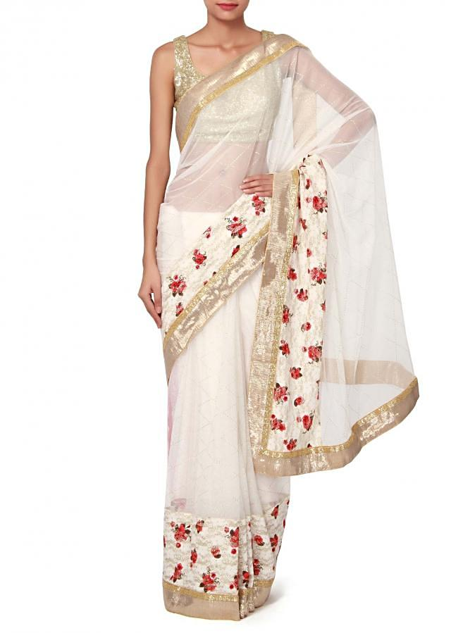 White saree enhanced in chantilly lace border only on Kalki