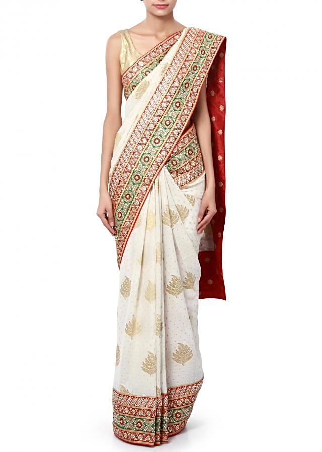 White saree enhanced in weave and kundan embroidery only on Kalki