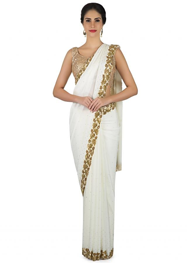White saree in georgette with leaf motif embroidery in cut dana work only on Kalki