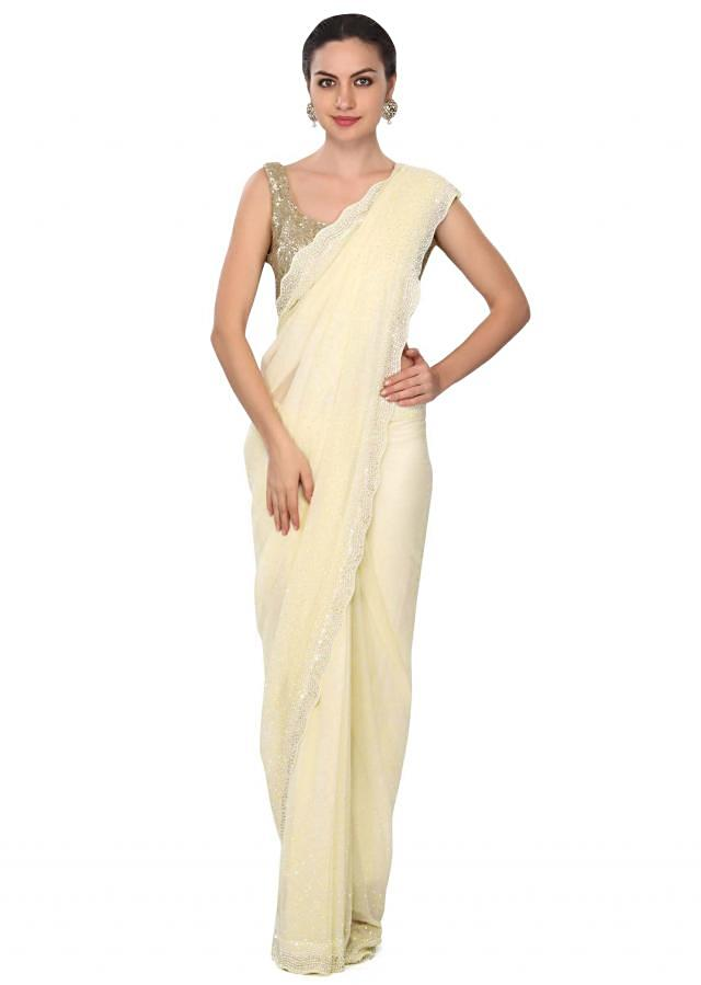 Cream saree with stone and pearl border only on Kalki