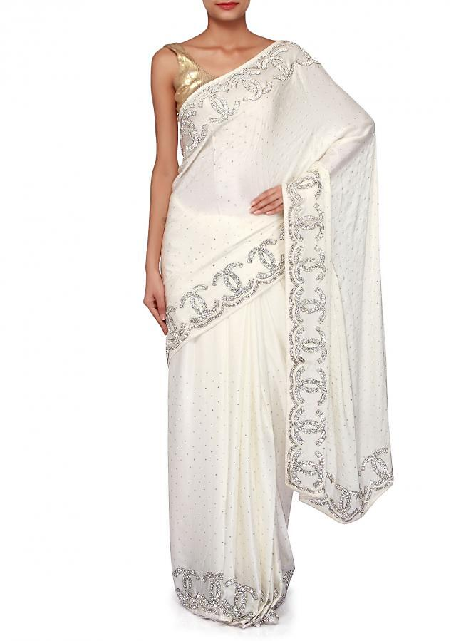 White satin saree adorn in kundan only on Kalki