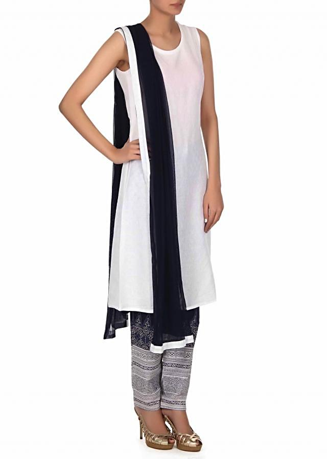 White suit Matched with embroidered cape only on Kalki