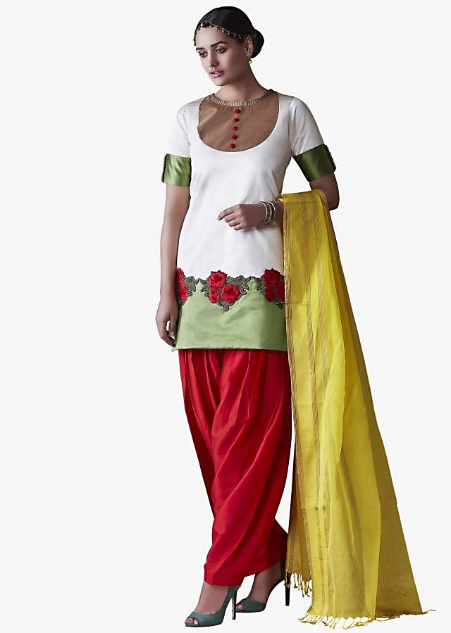 White and red suit matched up with yellow dupatta featuring the rose motif work