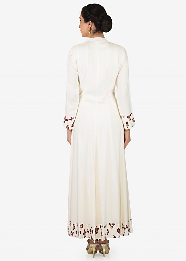 White cotton long dress embellished in thread and tassel work only on Kalki