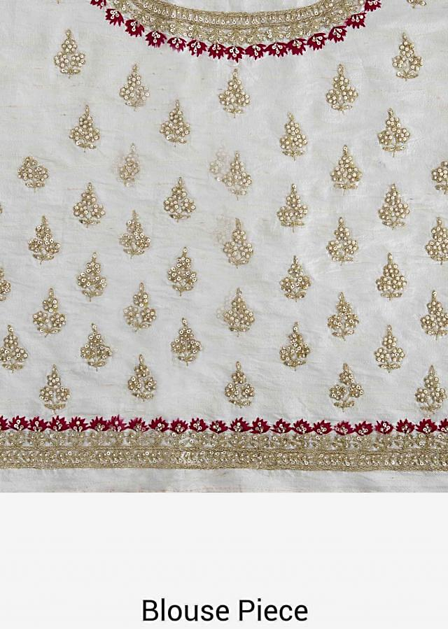 White lehenga in raw silk  embroidered in resham and moti embroidery work only on Kalki