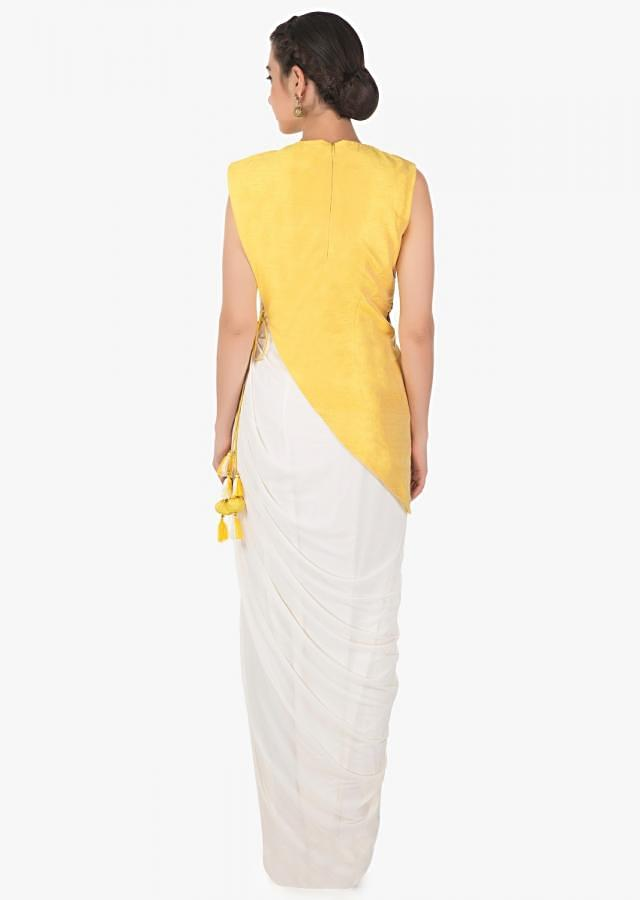 White long drape gown in lycra with yellow raw silk jacket only on Kalki