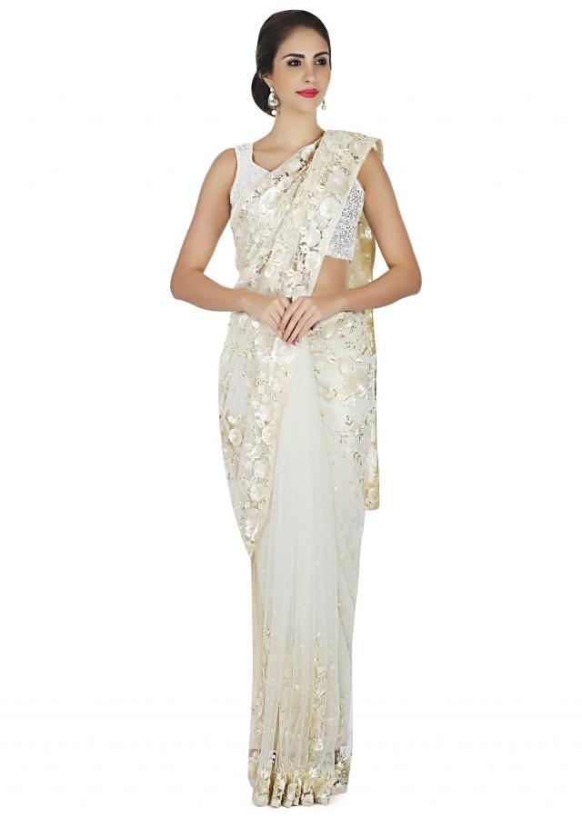 White saree in net embellished in resham and sequin embroidery only on Kalki