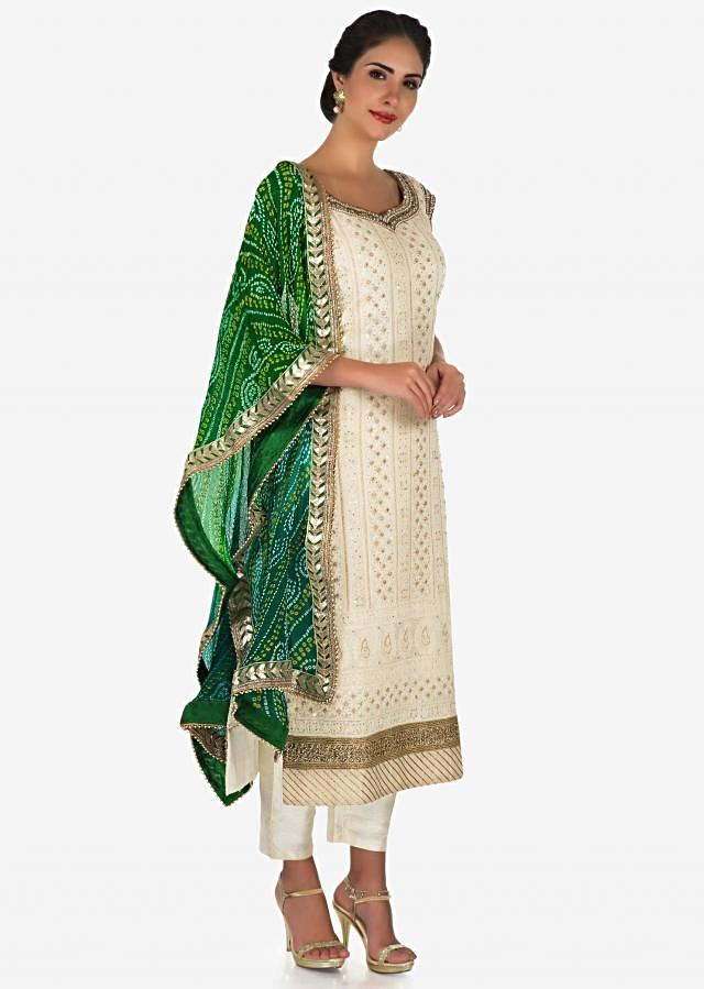 White suit with green bandhni dupatta adorn in lucknowi thread embroidery work only on Kalki