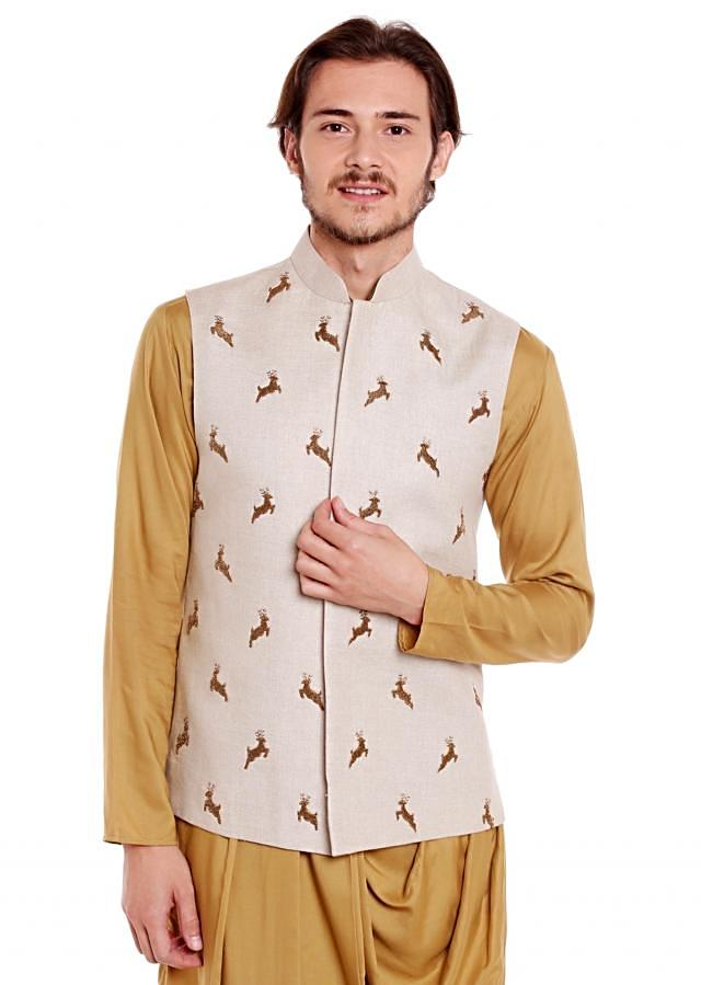 White waistcoat in raw silk embellished with a animal motif in zardosi embroidery only on Kalki