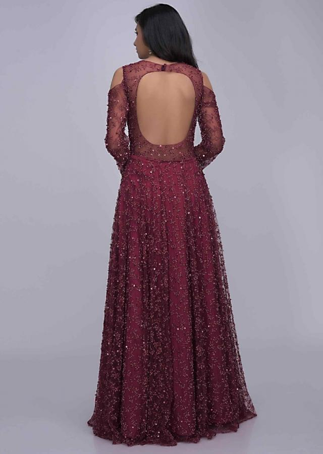 Wine colored ethnic gown in embroidered net fabric only on Kalki