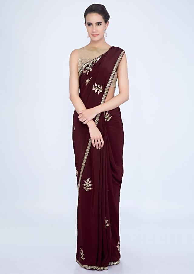 Wine crepe silk saree with embroidered butti and border only on Kalki