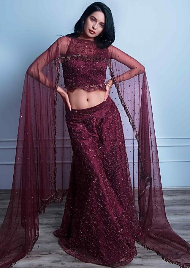 Wine Palazzo And Crop Top In Embroidered Net With Fancy Flared Cape Online - Kalki Fashion