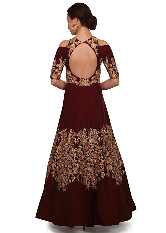 Wine gown in fancy cut out and floral motif work only on Kalki