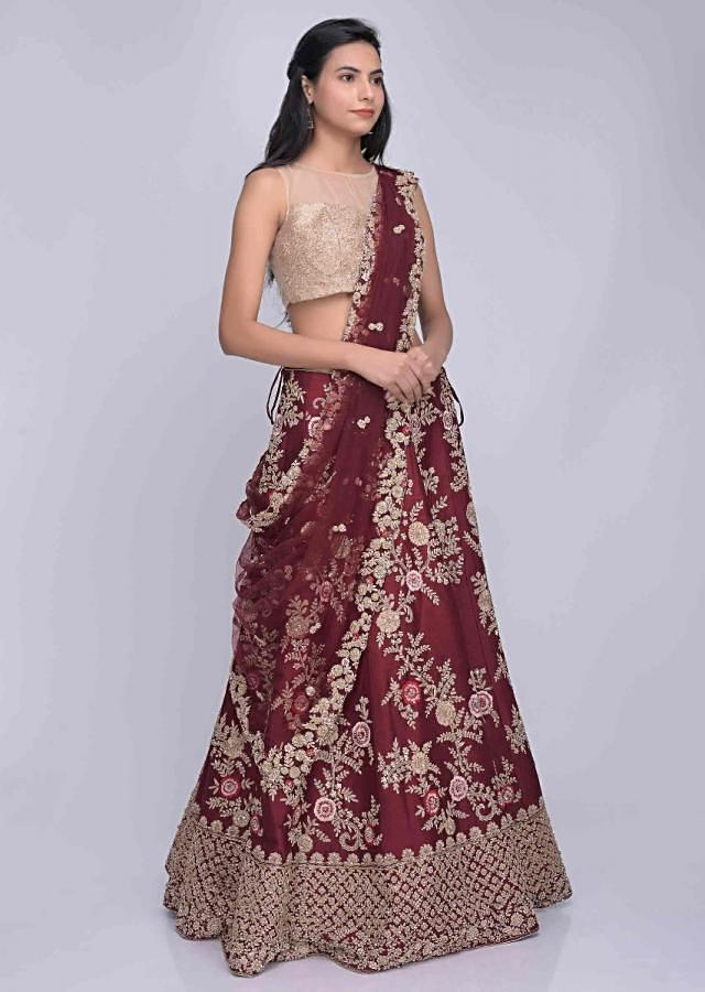 Wine red embroidered raw silk lehenga with net dupatta only on Kalki