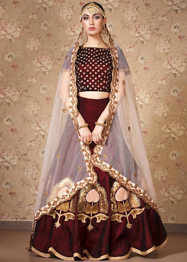 Wine lehenga and blouse in sequin work with sheer dupatta