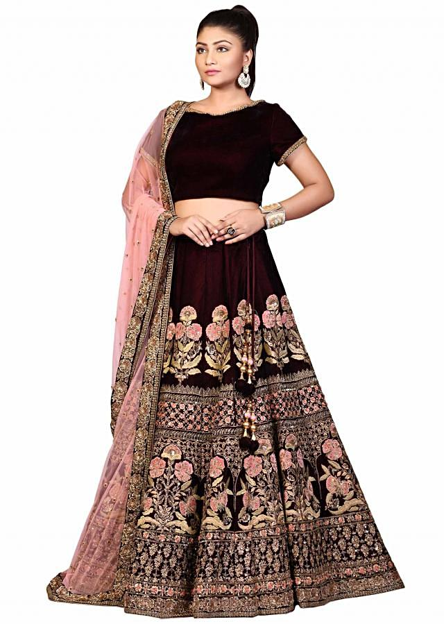 Wine lehenga featuring in velvet with floral embroidery in zardosi