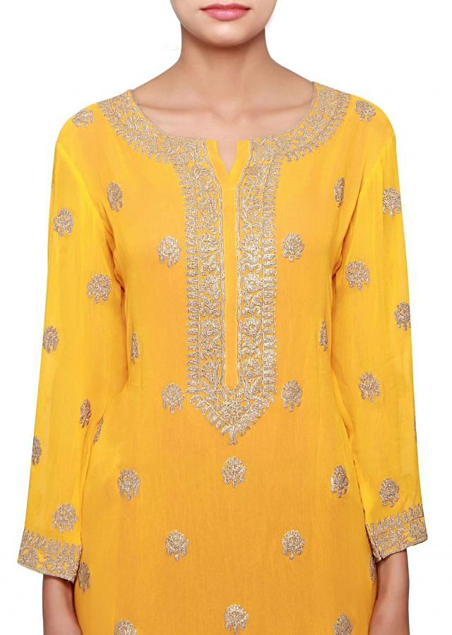 Yellow a-line kurti in georgette embellished in zari embroidery only on Kalki