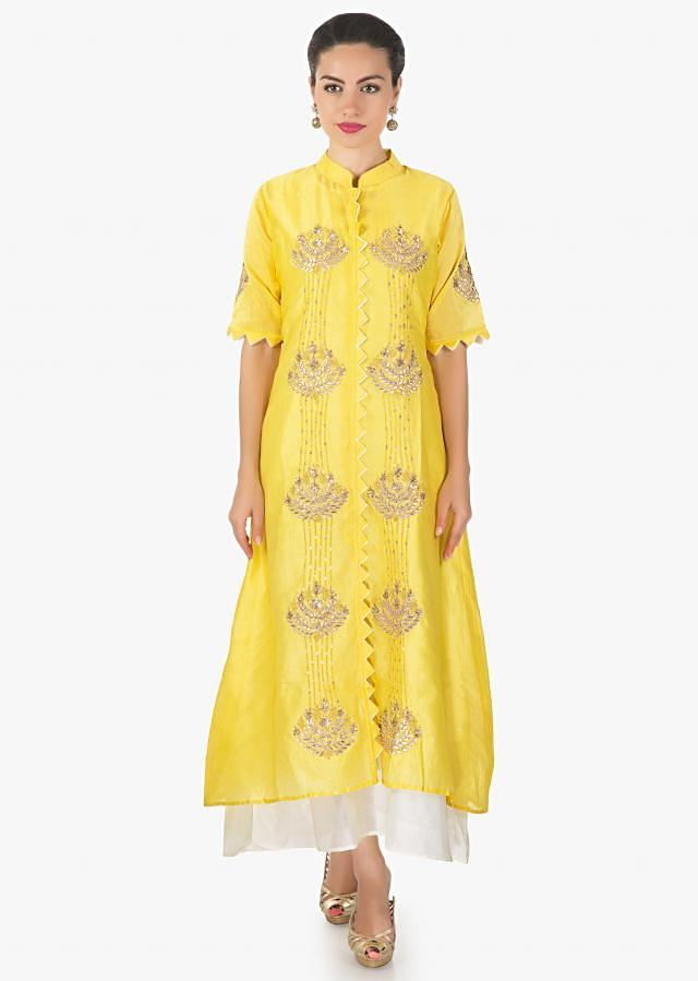 Yellow A line suit in gotta patch sequin work matched with white long inner only on Kalki