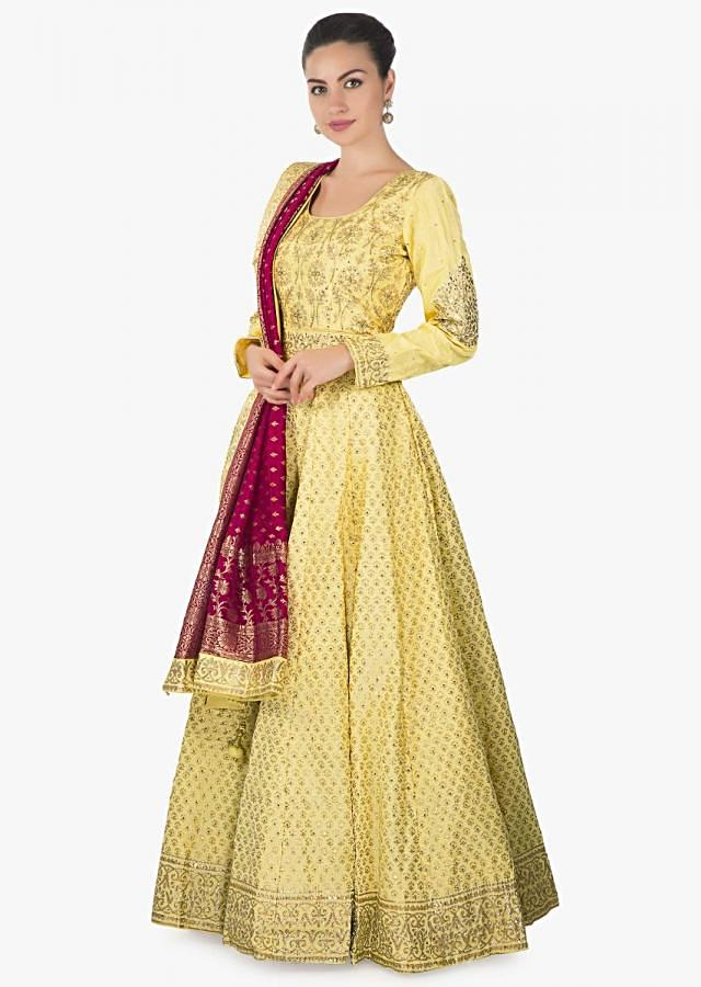 Yellow anarkali suit adorn in digital print further embellished in sequin only on Kalki