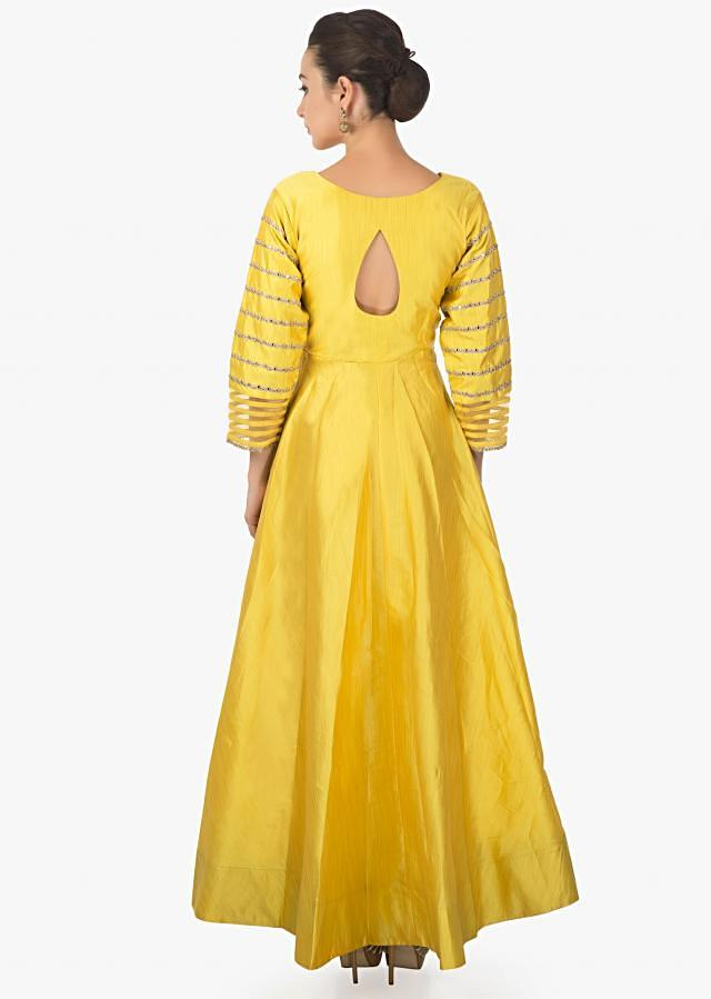 Yellow anarkali suit with cold shoulder and embroidered sleeve only on Kalki