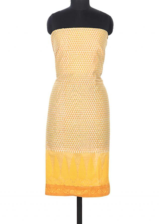 Yellow and cream unstitched suit in temple border only on Kalki