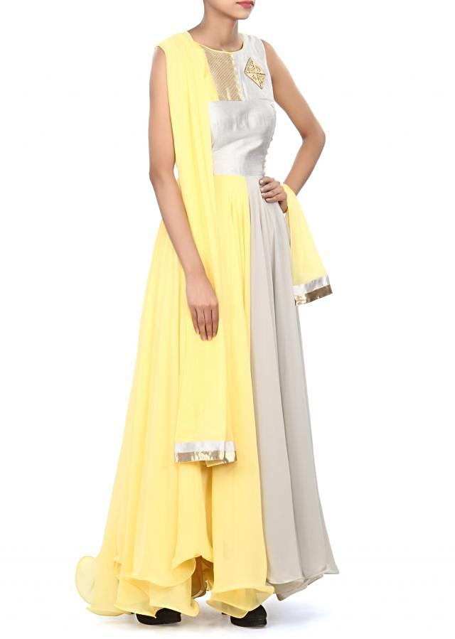 Yellow and grey anarkali suit enhanced in French knot embroidery only on Kalki