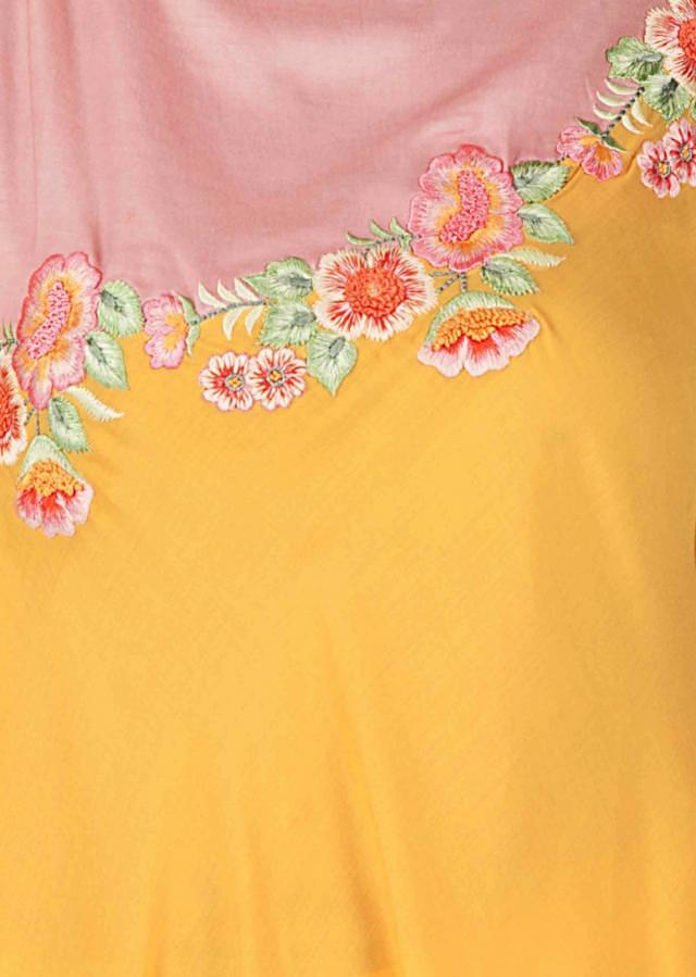 Yellow asymmetric suit with pink yoke embellished in resham and french knot work only on Kalki