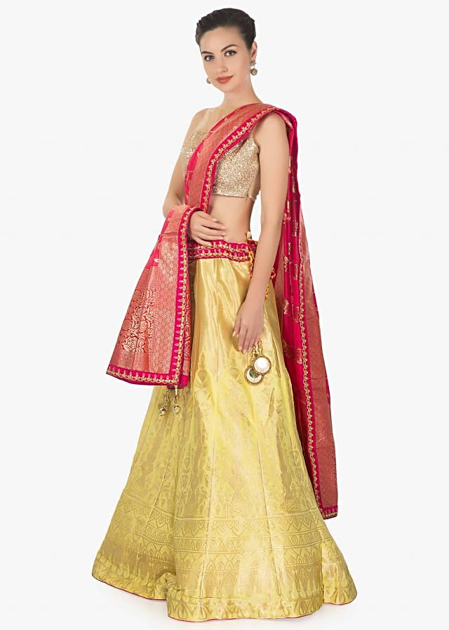 Yellow brocade silk lehenga featuring with rani pink brocade dupatta only on kalki