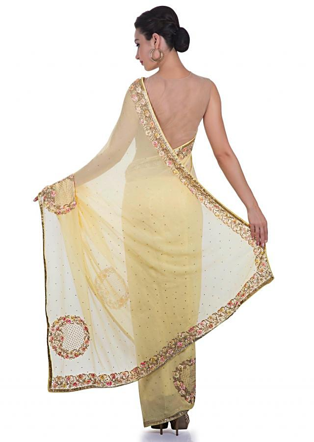 Yellow chiffon saree with floral motifs and sequins only on Kalki