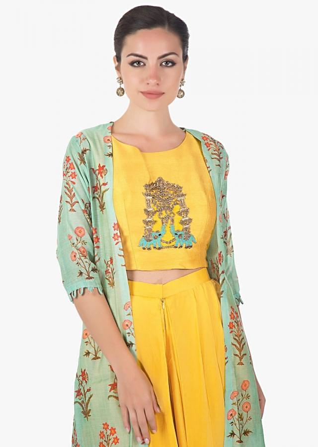 Yellow  crop top matched with fancy dhoti pant and a full length floral jackect only on kalki