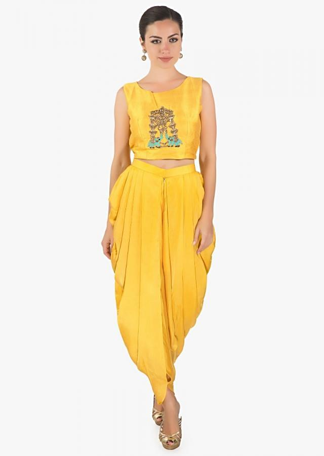 Yellow  crop top matched with fancy dhoti pant and a full length floral jacket only on kalki