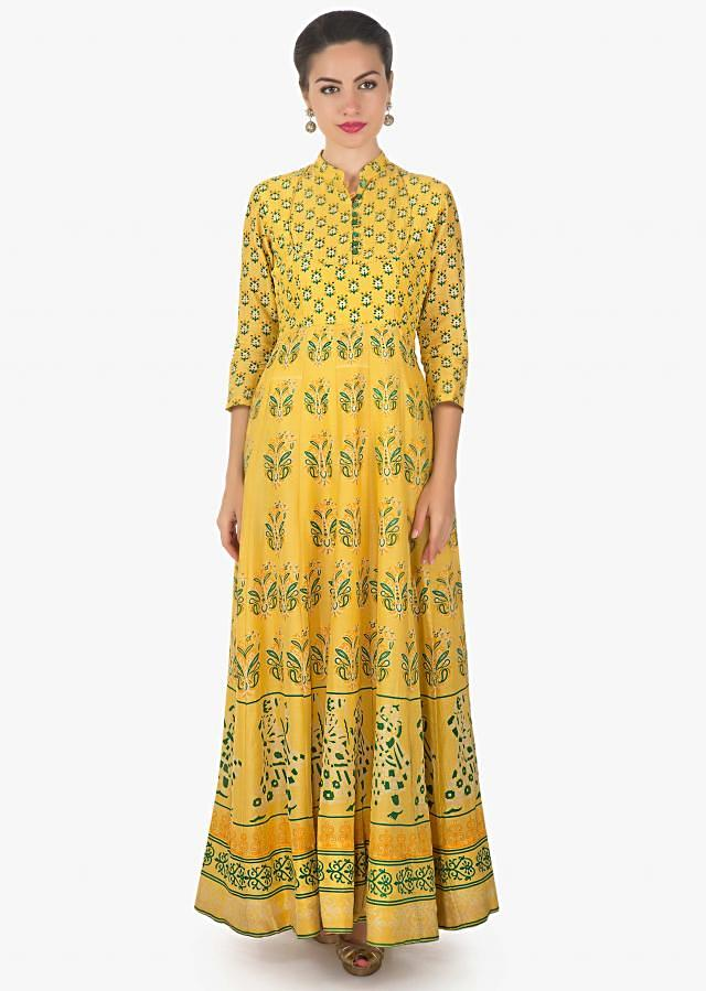 Yellow dress in cotton with floral printed butti only on Kalki