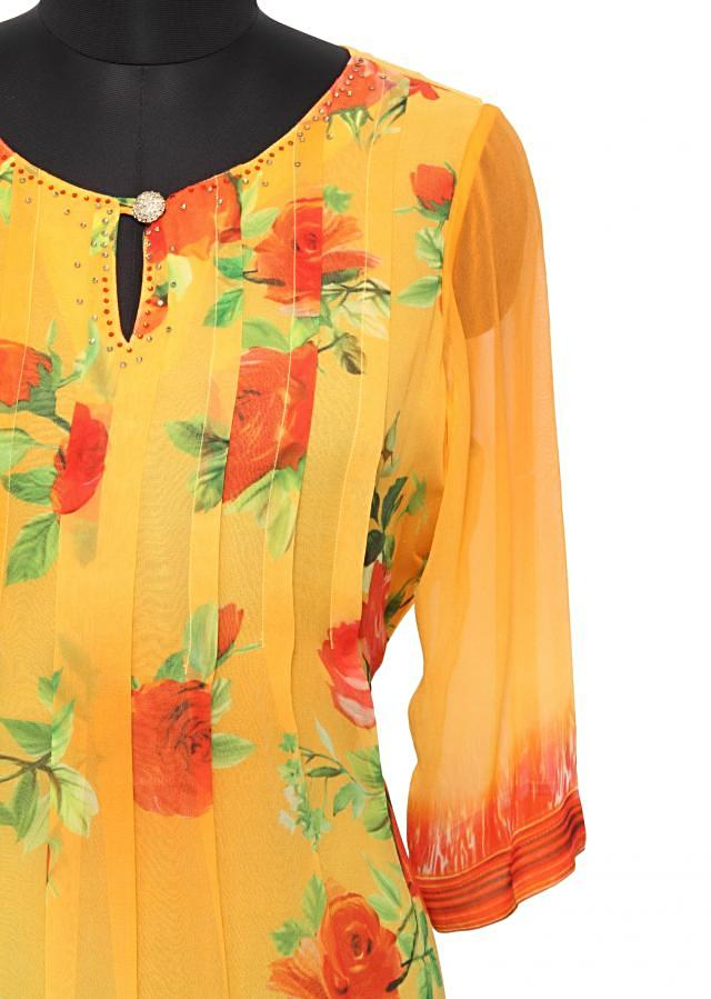 Yellow georgette printed kurti with pleats only on Kalki