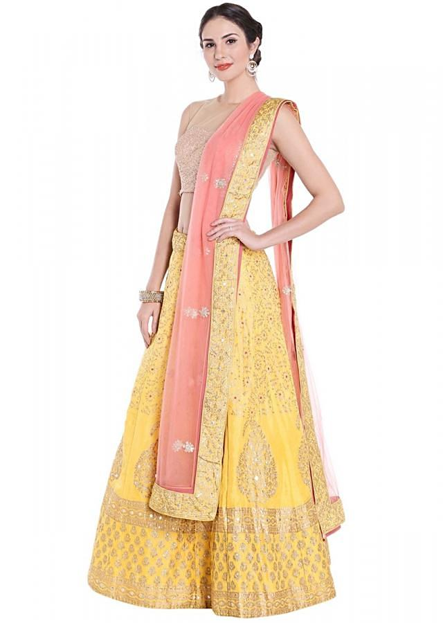 Yellow lehenga in foil printed butti matched with pink dupatta only on Kalki