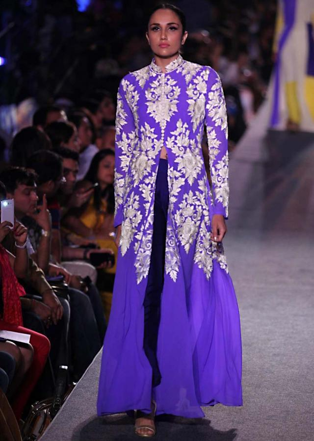 Model walks the ramp in yellow lehenga with white and purple embroidered blouse for Manish Malhotra Blue Runway collection at Lakme Fashion Week Summer Resort 2015