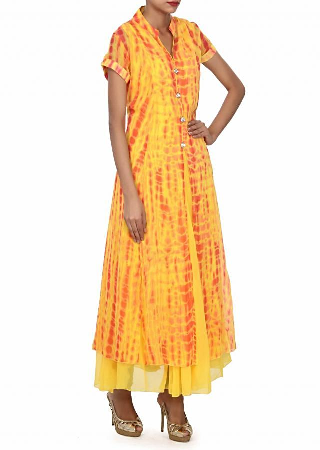 Yellow long dress adorn in fancy stone buttons only on Kalki