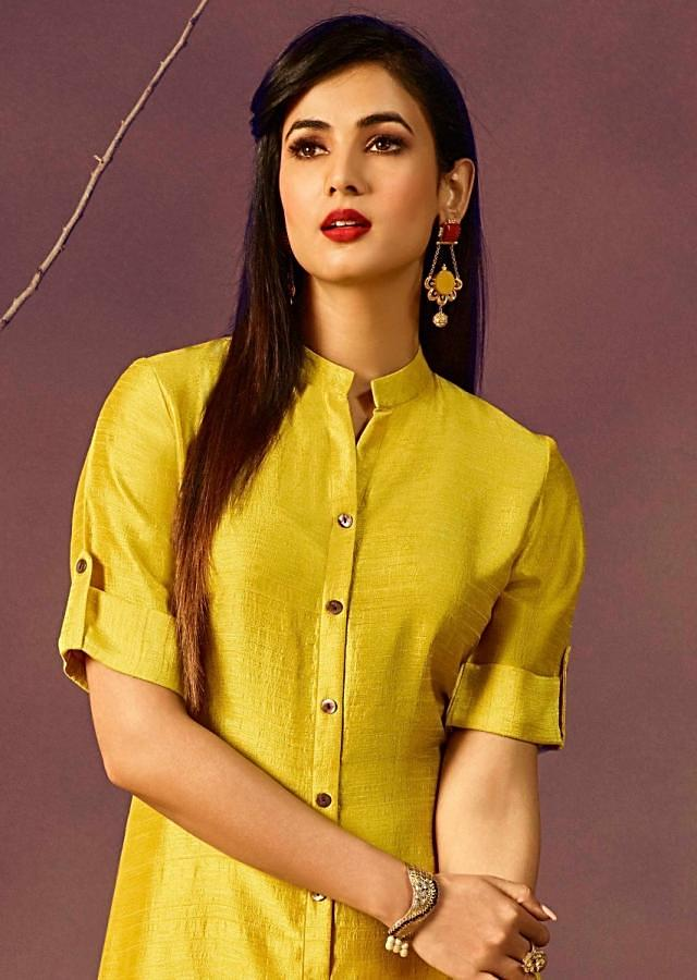 Yellow long kurti in silk with shell buttons on placket
