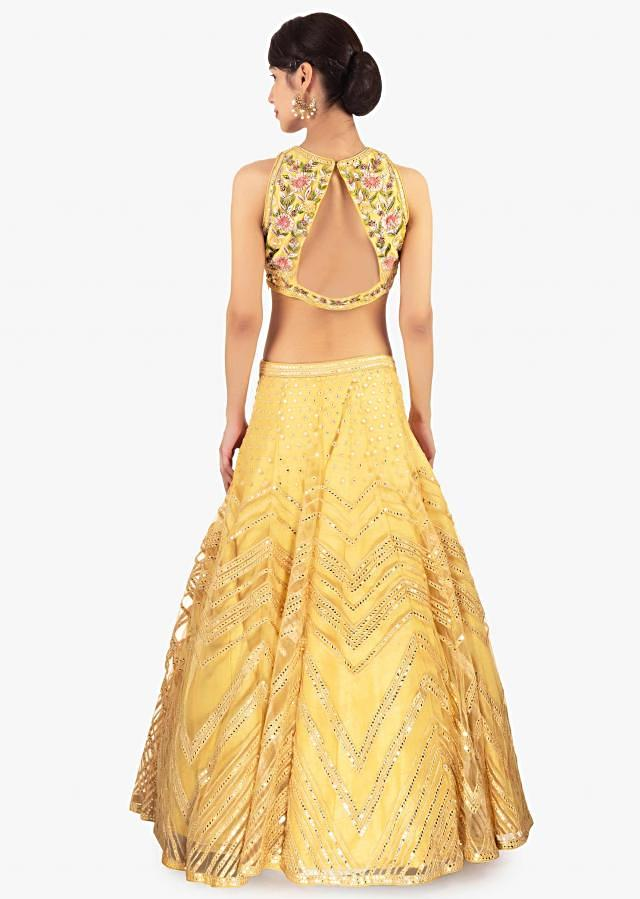 Yellow Lehenga Set In Net Paired With A Contrasting Off White Net Dupatta Online - Kalki Fashion