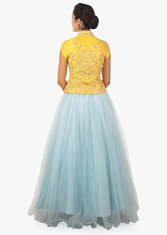 Yellow peplum top paired with a sky blue lehenga and shaded dupatta only on Kalki
