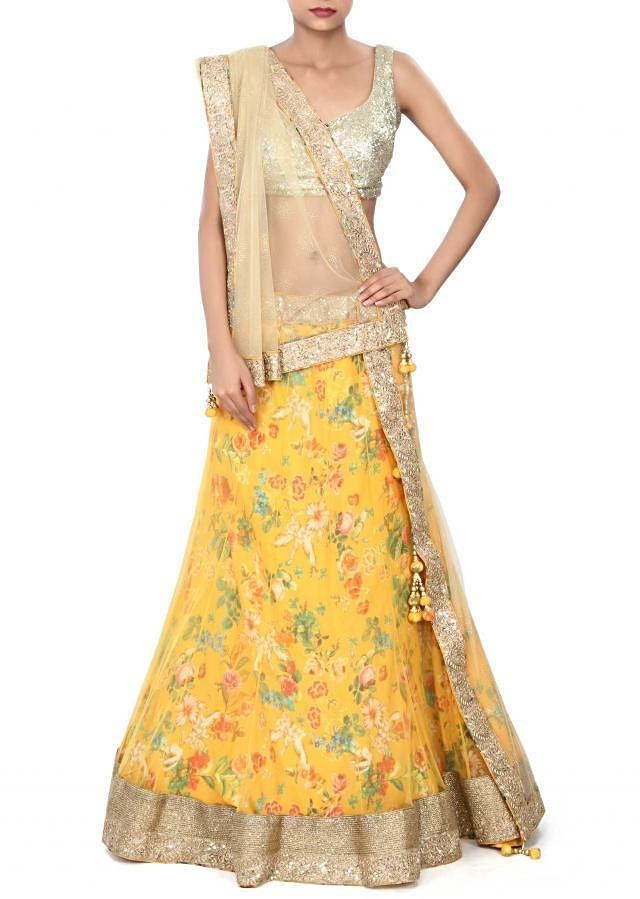 Yellow printed lehenga adorn in zari border only on Kalki