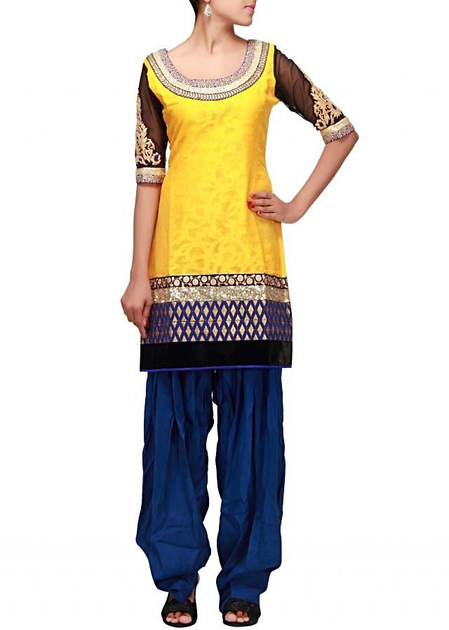 Yellow salwar suit featuring in zari and sequence embroidery only on Kalki