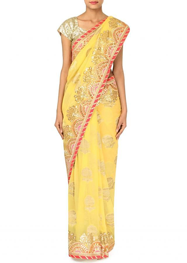 Yellow saree adorn in gotta patch embroidery only on Kalki