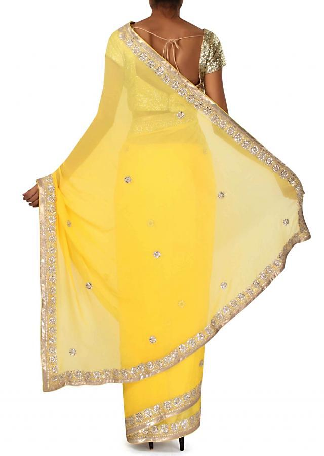 Yellow saree adorn in kundan embroidered border only on Kalki