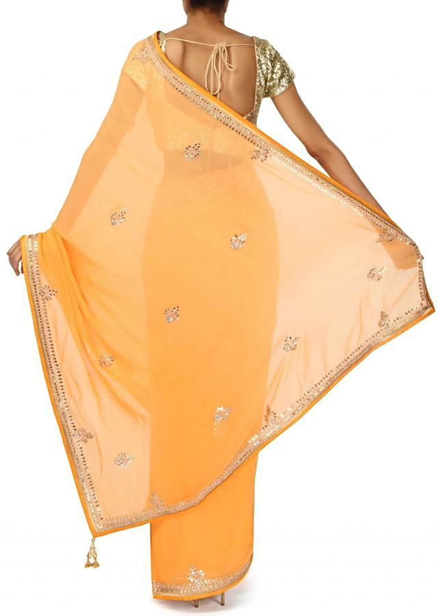 Yellow saree embellished in gotta patti border only on Kalki