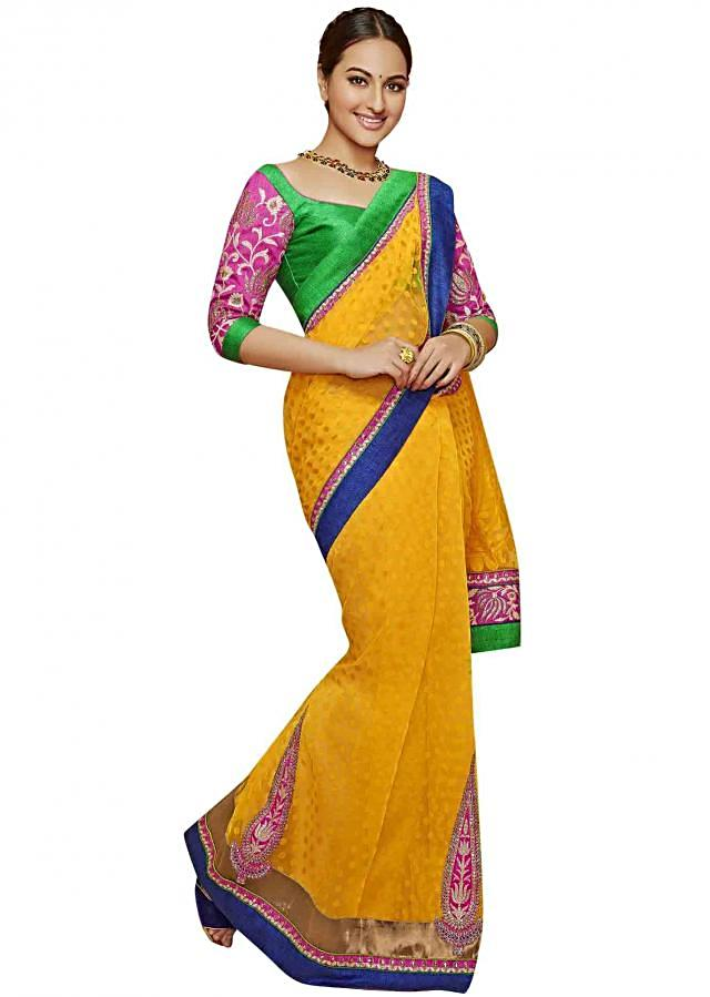 Yellow saree embellished in zari along with contrast border
