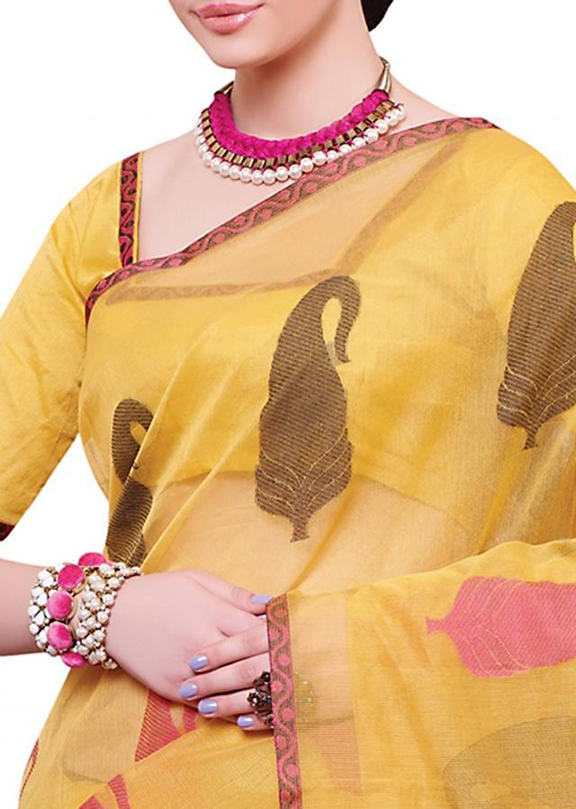 Yellow saree enhanced in paisley motif embroidery